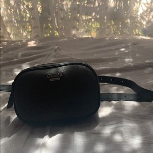 A black guess Fanny pack never used it brand new!